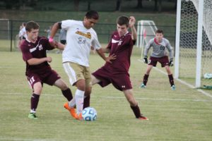 Senior Fernando Garcia defending himself against two Pike Central players.
