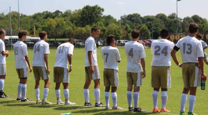 Boy's varsity soccer lines up to begin acknowledgements and the National Anthem.