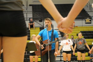 Riley Sample, Sophomore, and Justin Rottet, Senior, sing a duet during the Volleyball Leukemia night on October third. The duet sang one somber song together that had the crowd in tears. Their voices mix together perfectly to create goosebumps upon one's skin.